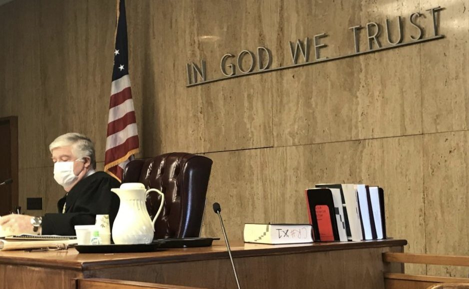Pete DeMola/Staff WriterState Supreme Court Judge Mark Powers reads a prepared statement in court Tuesday.
