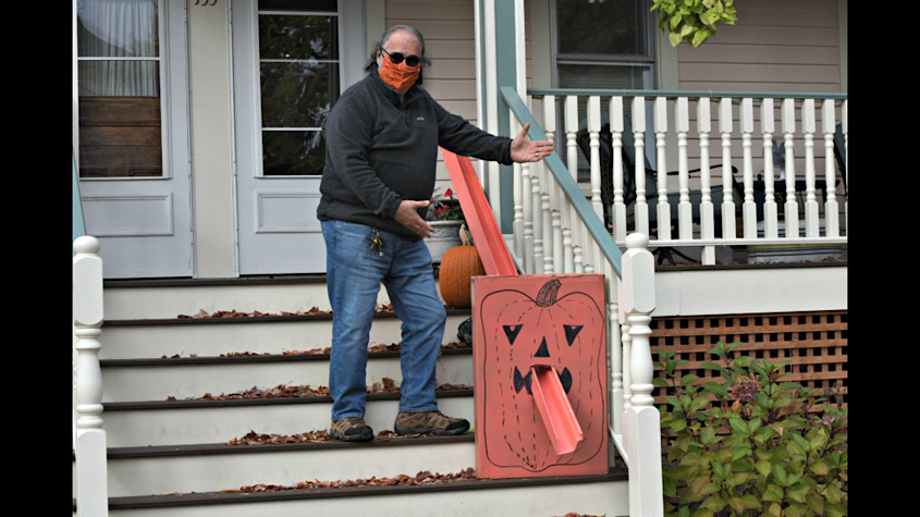 STAN HUDY/STAFF WRITERSaratoga Springs resident Chuck Vosganian shows off his socially distanced Halloween candy delivery system he built for $10.