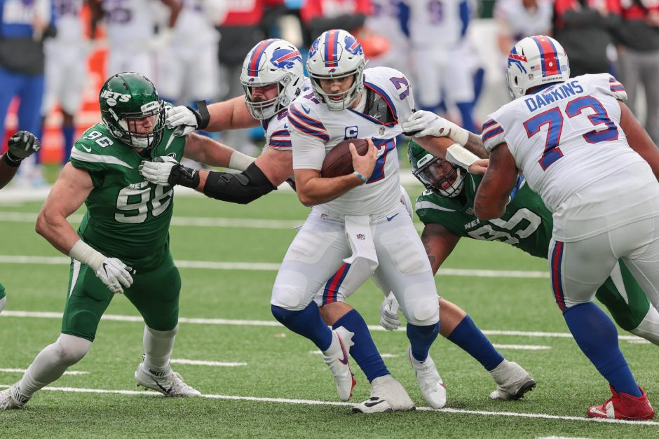 Vincent Carchietta/USA TODAY SportsBuffalo Bills quarterback Josh Allen carries the ball as New York Jets defensive end Henry Anderson, left, and defensive tackle Quinnen Williams attempt to make the tackle during thelast Sunday's game at MetLife Stadium.