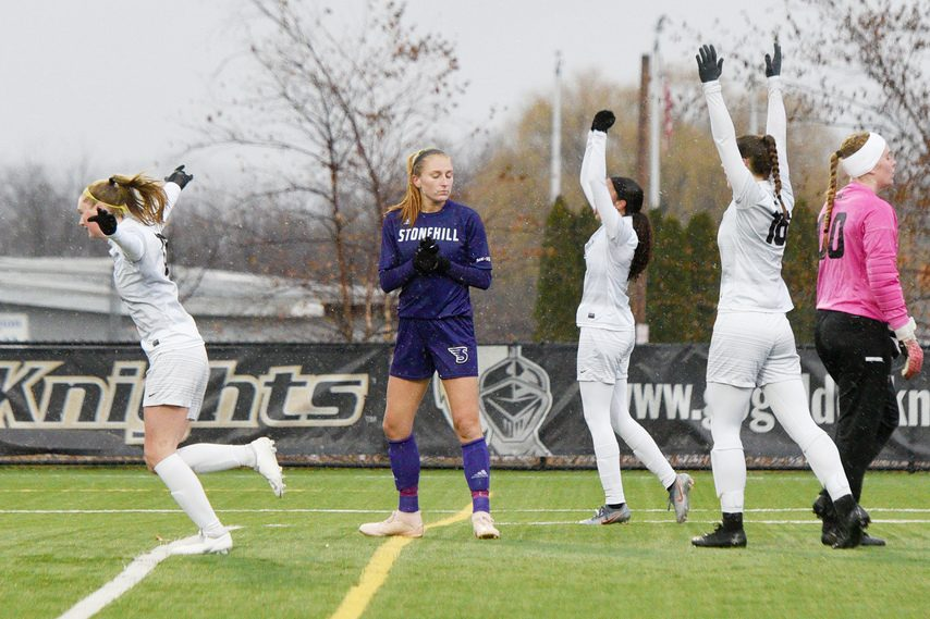 Saint Rose women's soccer players celebrate their first goal against Stonehill during their NCAA Division II soccer game at Plumeri Sports Complex in Albany on Nov. 24. (Erica Miller/Staff Photographer)