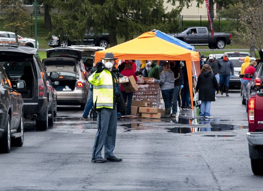 PETER R. BARBER/GAZETTE PHOTOGRAPHER Amid the COVID-19 shutdown that left many people unemployed, area residents lined up for a food distribution event at SUNY Cobleskill on May 1.