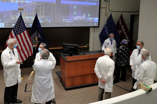 JOHN CROPLEY/BUSINESS EDITORMedical officials from eight Capital Region hospitals confer after a news conference at Albany Medical Center on Wednesday.