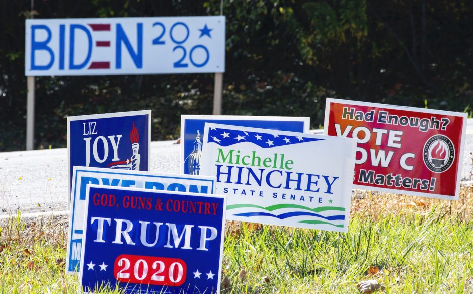 Political signs crowd the intersection of Route 159 and Putnam Road in Rotterdam Friday, October 23, 2020.