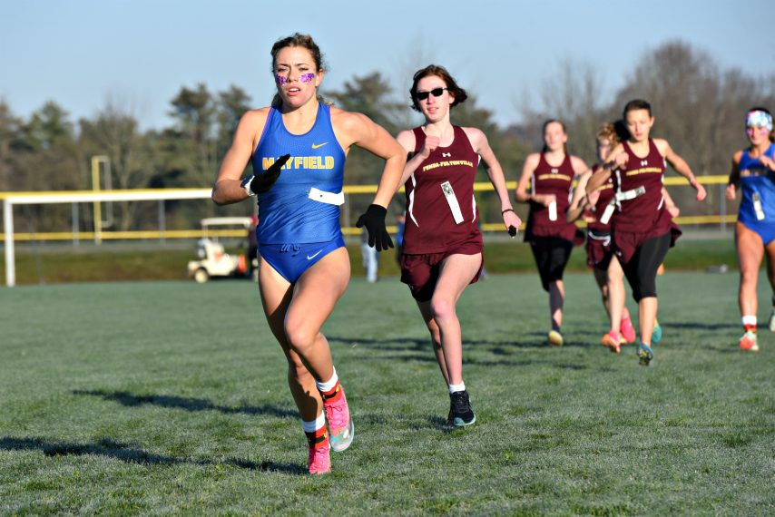 Mayfield's Madison Relyea pulls ahead of Fonda-Fultonville's Haley Clear early in the first girls' race during the Western Athletic Conference cross country championships on Saturday at the Fort Plain Sports Complex. (Adam Shinder/Staff Writer)