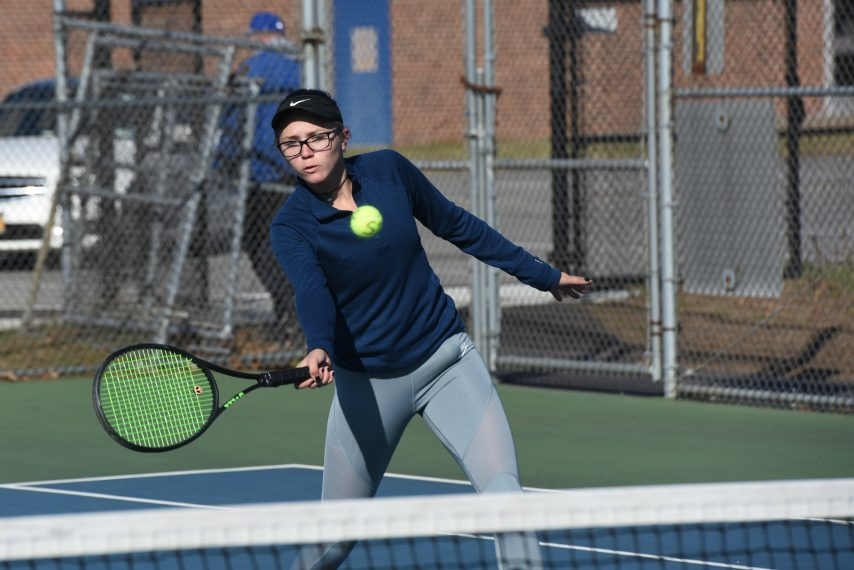 STAN HUDY/STAFF WRITERSaratoga Springs No. 1 singles player Katya Kelly returns a volley during warm-ups of the Suburban Council championships Saturday at Saratoga Springs High School.