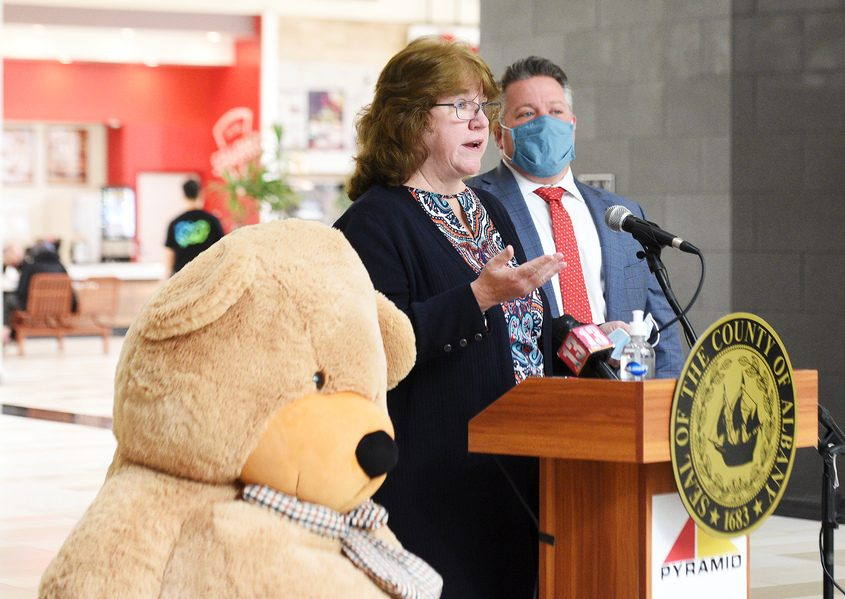 Albany County Executive Daniel McCoy listens Monday at Crossgates Mall as Albany County Department for Children, Youth and Families Commissioner Moira Manning announces details of the Adopt-A-Family holiday program. (Erica Miller/Staff Photographer)