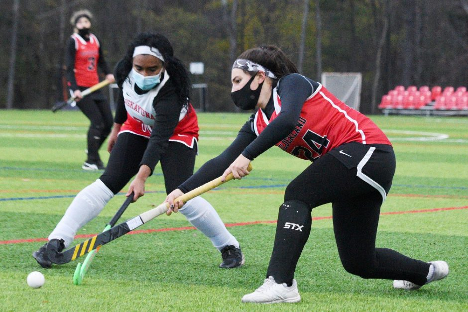 ERICA MILLER/STAFF PHOTOGRAPHER Guilderland's Giuliana Vivenzio with the ball againstNiskayuna's Olivia Reeves during their Suburban Council field hockey game Monday at Afrim's in Albany.
