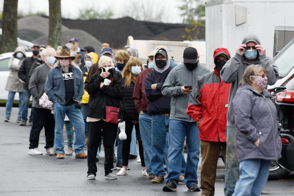 People stand in line for early voting at the Fulton County garage in Johnstown on Monday, Oct. 26. (Erica Miller/Staff Photographer)
