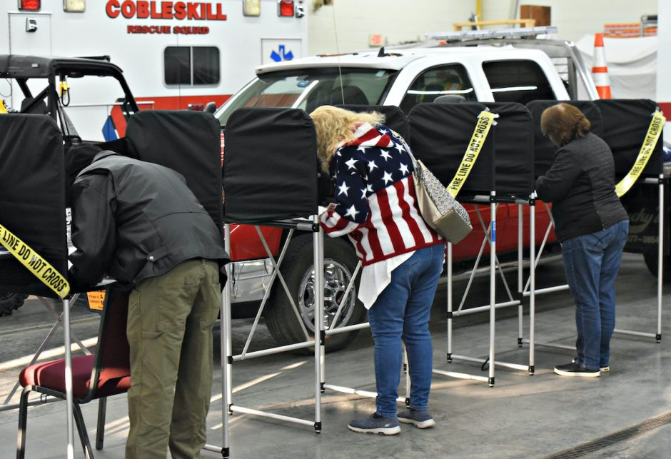 Voters fill in ballots, in socially distanced tables Tuesday afternoon, election day at the Cobleskill Fire House, Nov. 3, 2020.