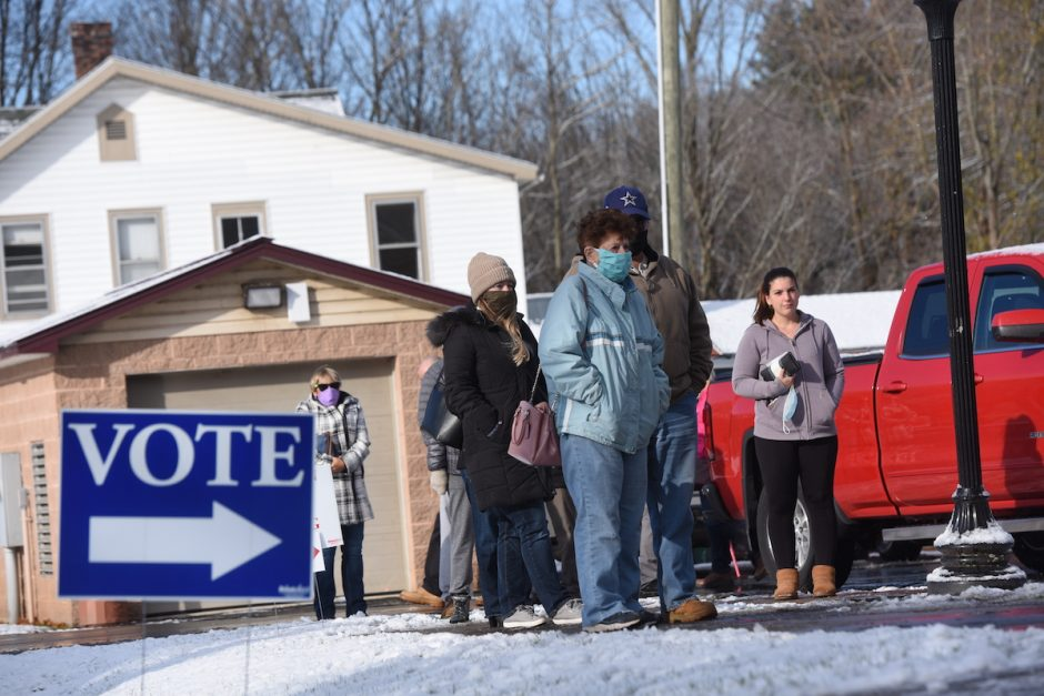 Voters wait to enter the Hagaman Volunteer Fire Department at 126 S. Pawling Street in Hagaman, the Town of Amsterdam District 2,3 and 4 voting precinct Tuesday morning on election day. Nov. 3, 2020.