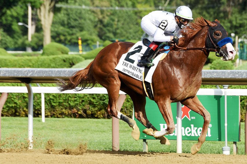 ERICA MILLER/STAFF PHOTOGRAPHER Improbable and jockey Irad Ortiz Jr. win the Whitney at Saratoga Race Course on Aug. 1.