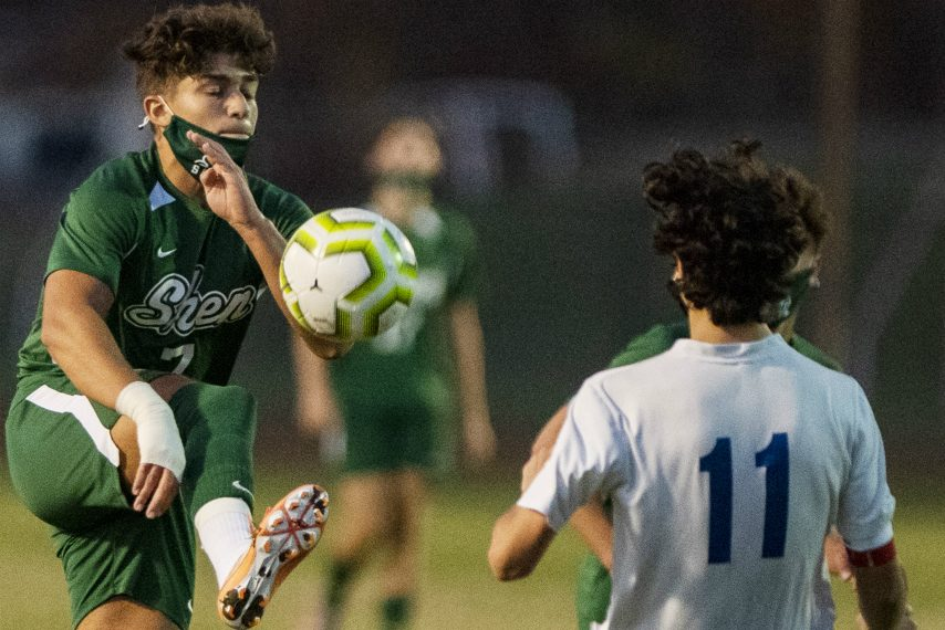 Shenendehowa's Emir Cekic, left, handles the ball during Friday's game against Saratoga Springs. (Peter R. Barber)
