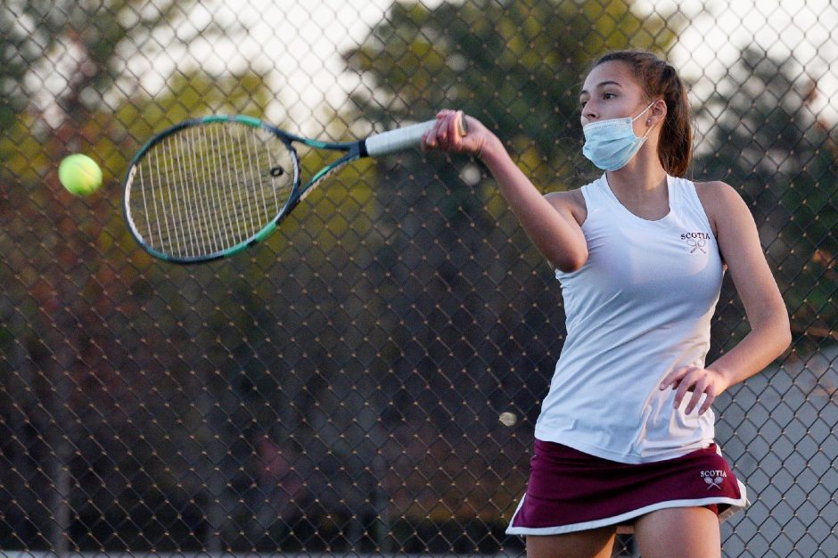 ERICA MILLER/STAFF PHOTOGRAPHER Scotia-Glenville senior Charlotte Tvelia hits a shot during the Tartans' Foothills Council girls' tennis championship against Queensbury on Friday.