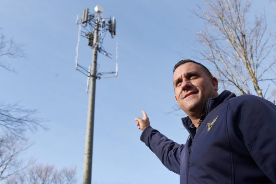 ERICA MILLER/STAFF PHOTOGRAPHER Saratoga County commissioner of emergency services, Carl Zeilman, points to one of the county's communications towers that Verizon is using to install cellphone technology. This tower is located in Edinburgh.