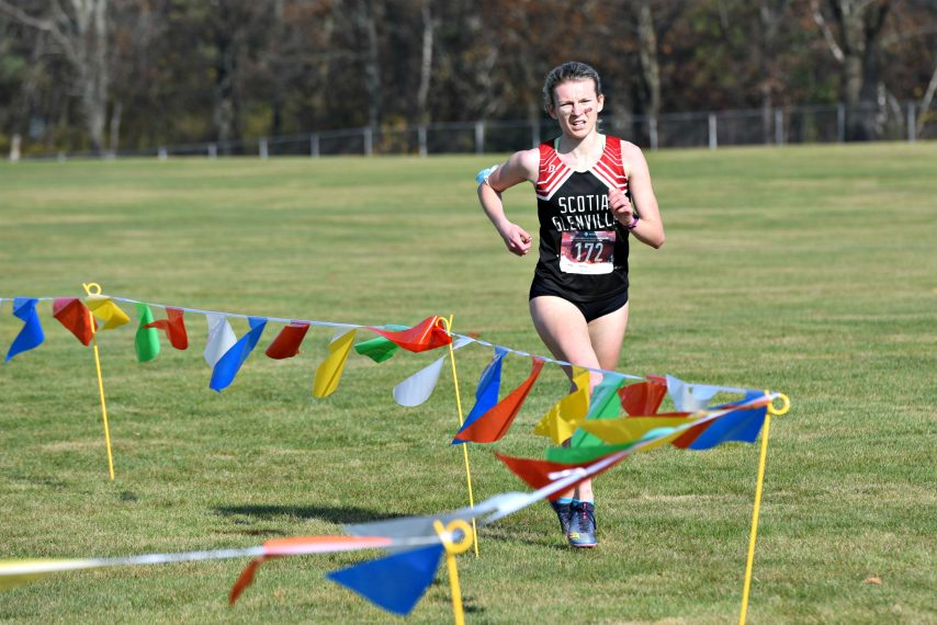 STAN HUDY/STAFF WRITERScotia-Glenville senior Delaney Krogh approaches the final turn Saturday morning during the Foothills Council cross country championships at Queensbury High School.