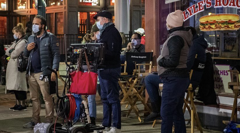 Producer Sean Fogel, right, looks on as the director John Crowley oversees the filming a scene for Modern Love on State Street near Johnny's Restaurant Friday night