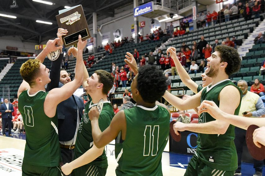 Schalmont celebrates its win over Mechanicville in last season's Section II Class B championship basketball game at Cool Insuring Arena in Glens Falls.. (Erica Miller)