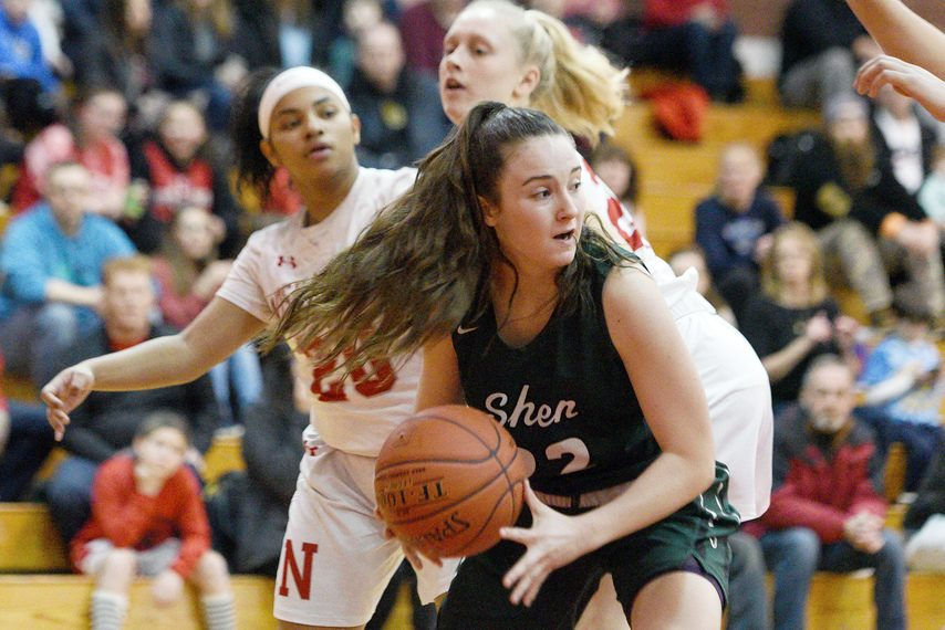 Shenendehowa's Kaitlyn Watrobski with the ball against Niskayuna's Ivian Owens and Heather Schmidt during their high school basketball game at Niskayuna High School on Jan. 31.