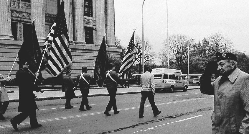 Francis Scavio, a World War II veteran, salutes members of a marching division during Albany's 1984 Veterans Day Parade.