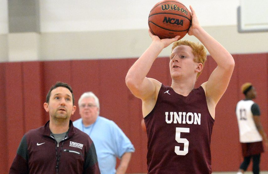 Union College basketball player Mike Concannon with coach Chris Murphy in background during a Dec. 5 practice. (Gazette file photo)