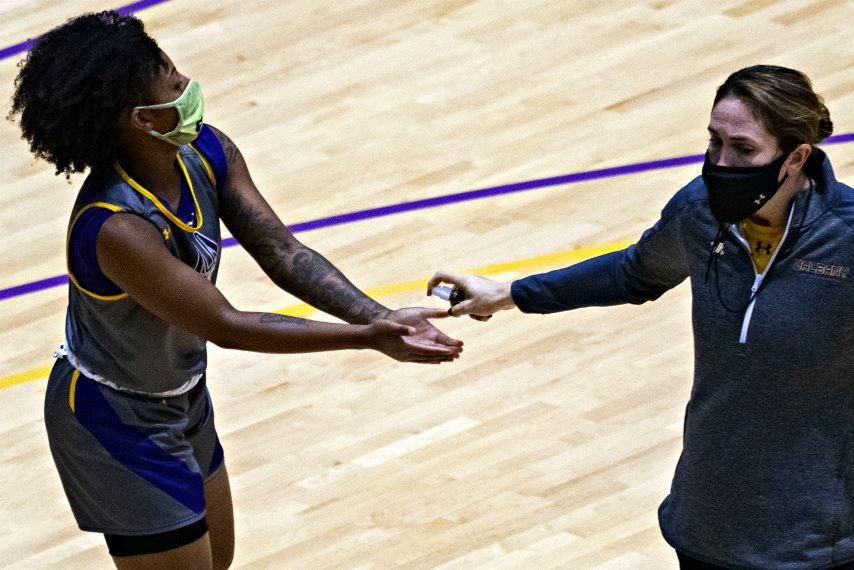 Kyara Frames, left, uses hand sanitizer during a recent UAlbany women's basketball practice. (Gazette file photo)