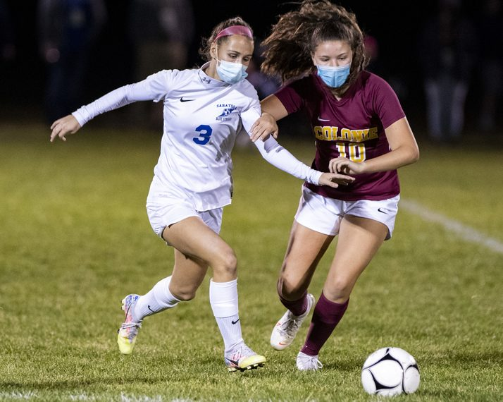 PETER R. BARBER/STAFF PHOTOGRAPHEREmme Baldwin of Saratoga Springs, left, and Colonie€'s Isabella Franchi go after the ball Tuesday night in a Suburban Council soccer game at Colonie High School.