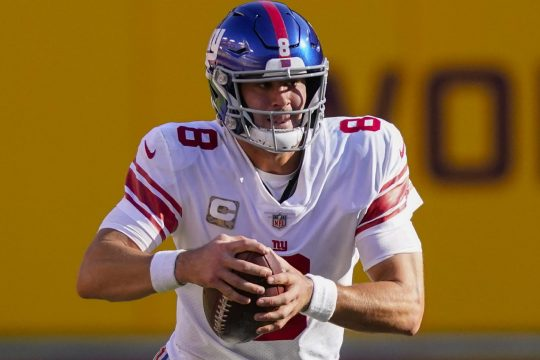 (AP Photo/Al Drago)New York Giants quarterback Daniel Jones scrambles with the ball in the first half of Sunday's game against the Washington Football Team in Landover, Md.
