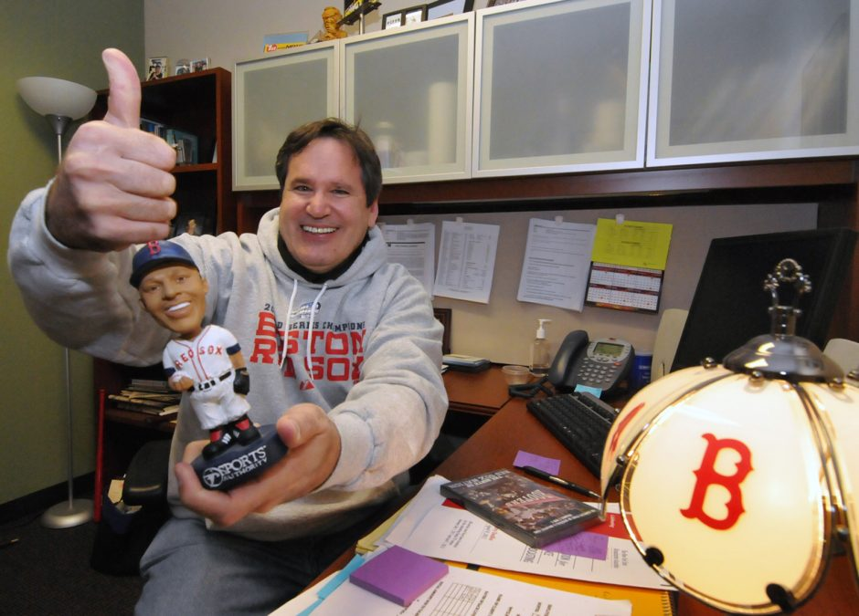 """WGY 810 AM, 103.1 FM radio personality Chuck Custer, a diehard Boston Red Sox fan, is seen in his officein this file photo. Custer, co-host of the morning show """"Chuck & Kelly,"""" has announced he will retire next month. (Marc Schultz/Staff Photographer)"""