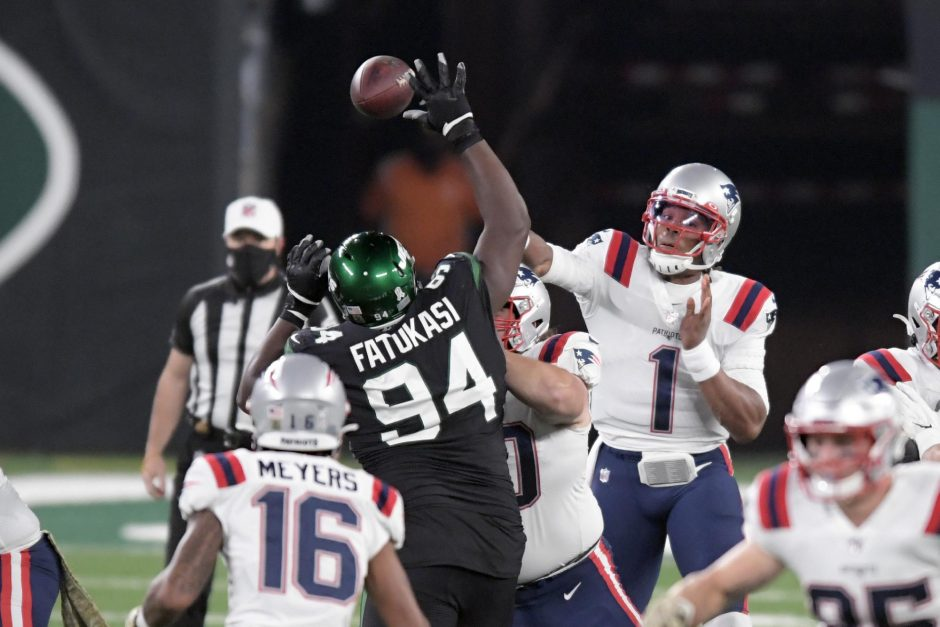 Bill Kostroun/The Associated PressNew England Patriots quarterback Cam Newton (1) throws a pass as New York Jets defensive tackle Foley Fatukasi (94) attempts to get a hand on it during Monday's game at MetLife Stadium.