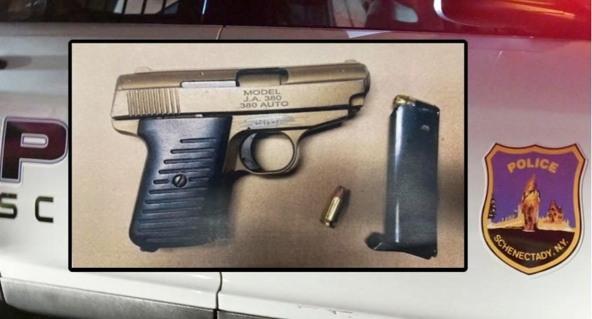 The seized gun. Credit: Schenectady Police Department (inset); File (Background)
