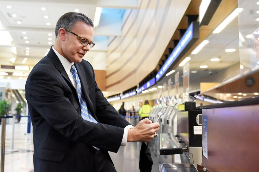 ERICA MILLER/STAFF PHOTOGRAPHER GE Research spokesman Todd Alhart demonstrates the Wellness Trace App at Albany International Airport in Latham on Thursday, November 12, 2020.