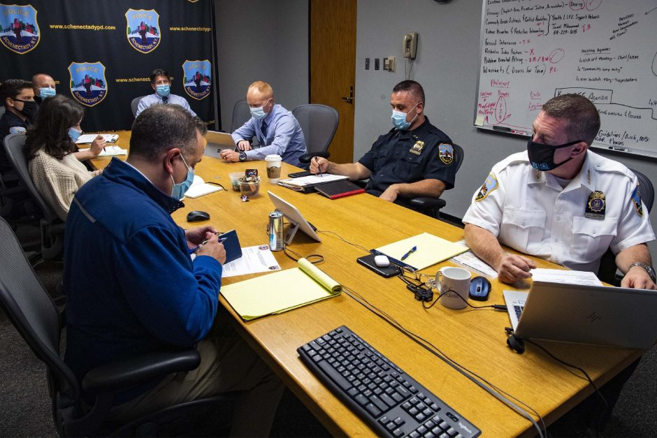 PETER R. BARBER/STAFF PHOTOGRAPHERThe Schenectady police command staff prepares for a virtual meeting at Police Headquarters on Oct. 22.