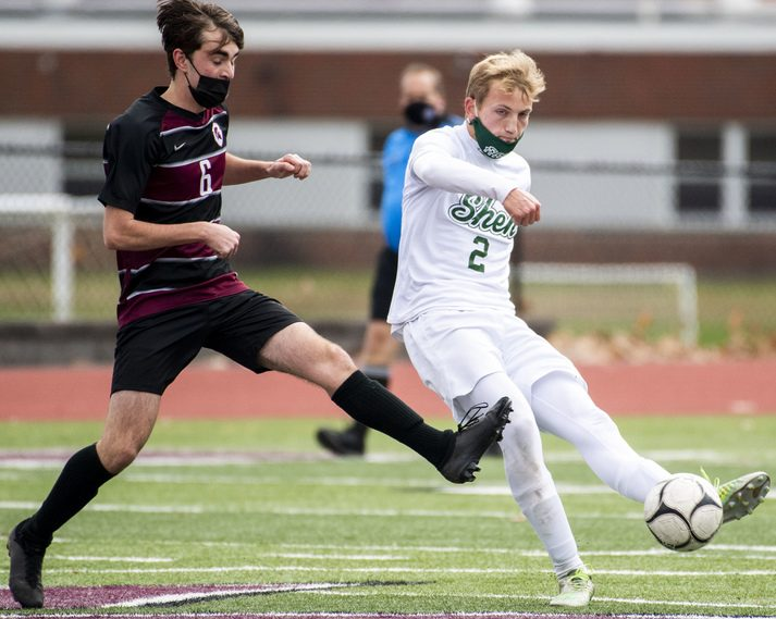 PETER R. BARBER/STAFF PHOTOGRAPHERShenendehowa'€™s Brandon Barrett, right, clears the ball past Owen Hughes of Burnt Hills-Ballston Lake during Saturday's Suburban Council soccer game at Centennial Field.
