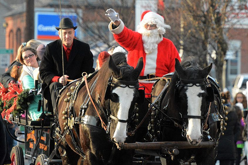 Santa gets a ride with Classic Carriage of Johnstown at the village of Scotia's 21st annual Holiday on the Avenue in 2017.