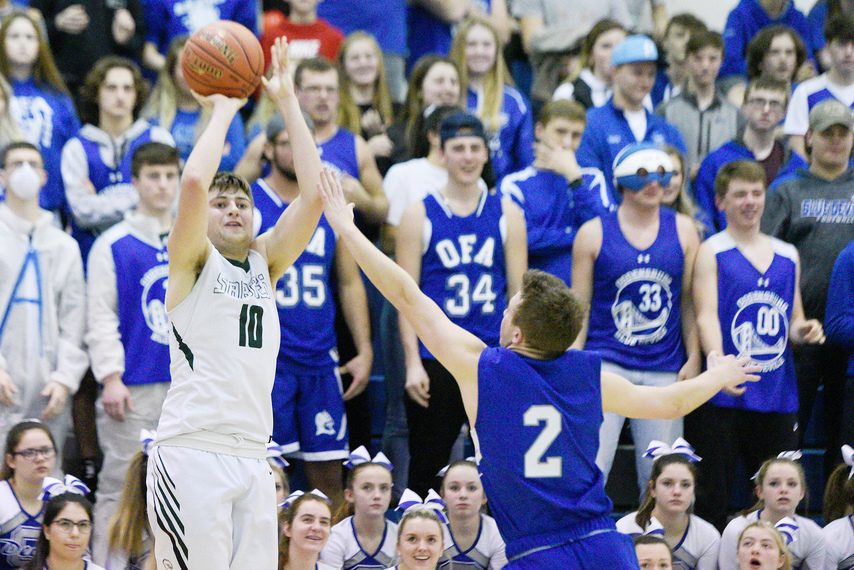 Schalmont's Austin Redmond takes a shot against Ogdensburg's Connor Griffith during the Class B basketball regional semifinals at Saratoga Springs High School on March 10.