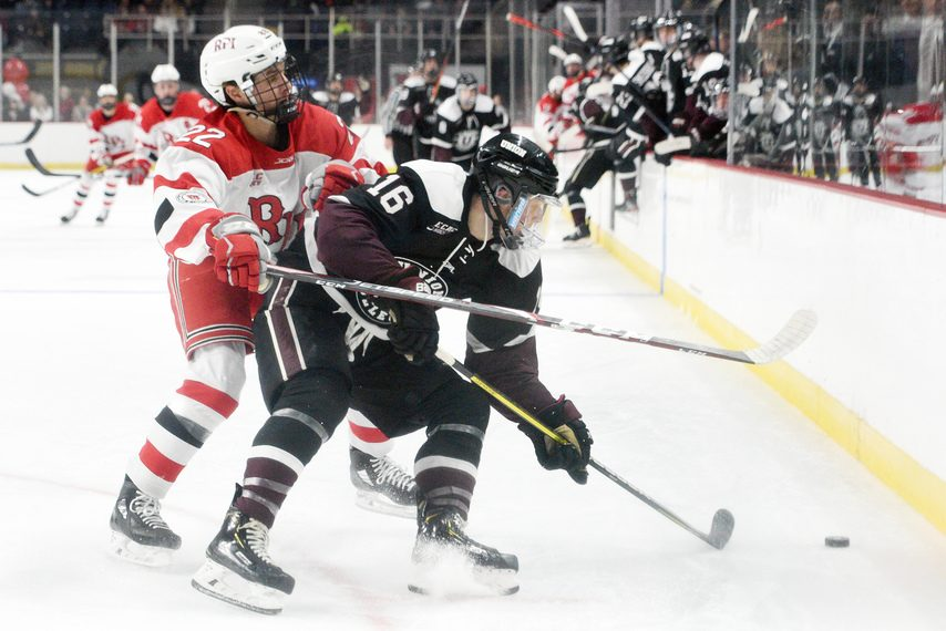 RPI's Cory Babichuck checks Union's Christian Sanda during the Mayor's Cup at Times Union Center in Albany onJan. 25.