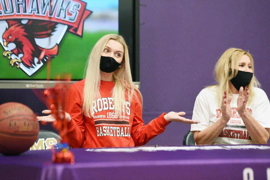 ERICA MILLER/STAFF PHOTOGRAPHER Amsterdam girls' basketball player Andie Gannon, left and her mom Sue react after signing her National Letter of Intent play basketball at Roberts Wesleyan College on Tuesday at Amsterdam High School.