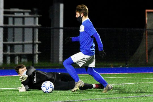 Saratoga Springs' Evan Hallett gets around Guilderland goalkeeper Peter Schultz to score the first goal of the game during a Suburban Council boys' soccer quarterfinal on Tuesday at Saratoga Springs High School.
