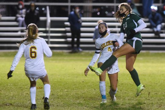 Shenendehowa's Brooke DelSignore rips a shot on goal in front of Colonie's Sofia Sanzo (4) and Julia Bancheri (6) Tuesday evening during the Suburban Council quarterfinals at Shenendehowa. (Stan Hudy)