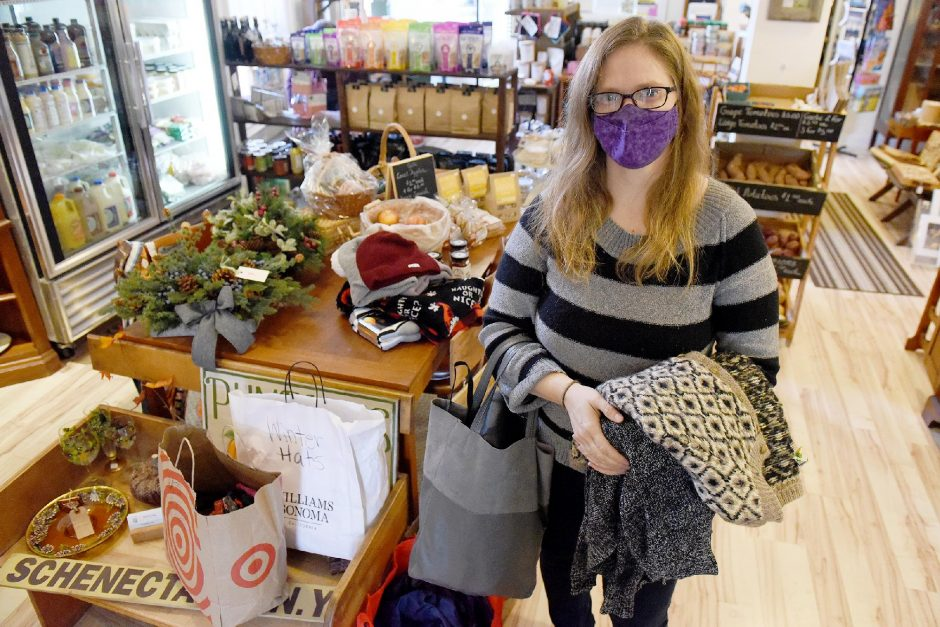 ERICA MILLER/STAFF PHOTOGRAPHER Owner of The Schenectady Trading Company Caroline Bardwell, of Schenectady, stands with recent donations to Street Soldiers from residents inside her store on Union Street in Schenectady on Wednesday, November 18, 2020.