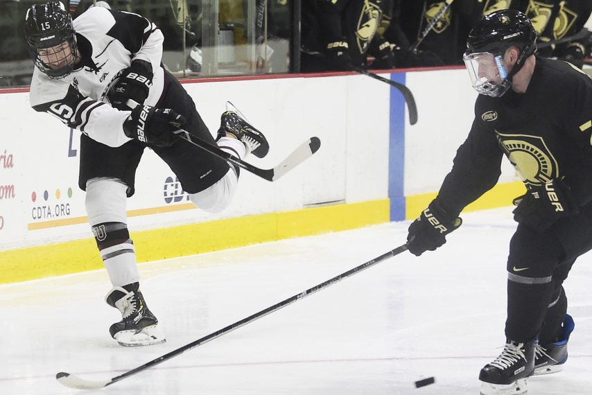 PETER R. BARBER/GAZETTE PHOTOGRAPHERUnion forward Jack Adams, left, takes a shot against Army at Messa Rink on Oct. 6, 2018.