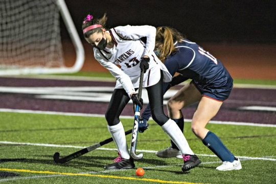 Burnt Hills'MaddyConnelie, left, works to gain possession of the ball during Wednesday's field hockey game against Saratoga Springs. (Peter R. Barber)