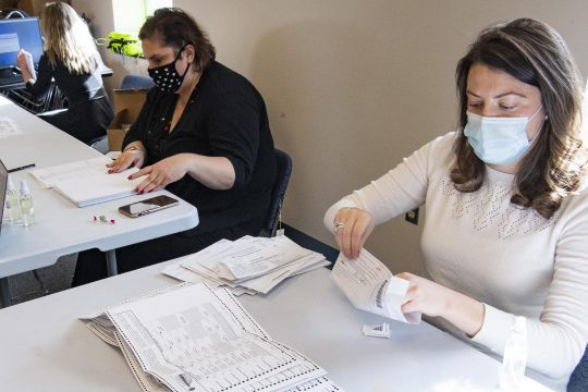 Melissa Kermani of Delmar, left, and Barbara Gaffuri of Albany count mail-in ballots at the Albany County Board of Elections in Albany on Thursday. (Peter R. Barber/Staff Photographer)