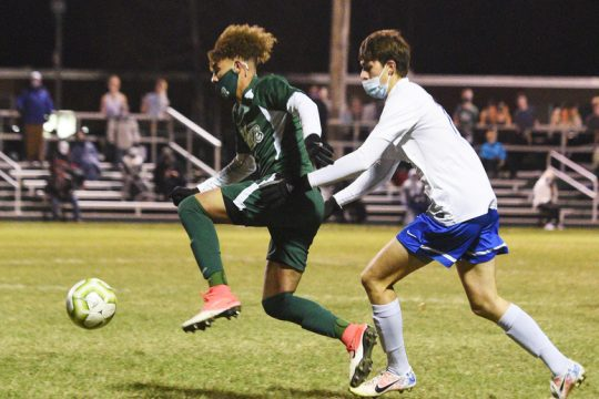 ERICA MILLER/STAFF PHOTOGRAPHER Shenendehowa's Darien Espinal dribbles the ball past Anthony Borelli of Saratoga Springs before scoring his goal in Thursday night's Suburban Council boys' soccer tournament semifinal game at Shenendehowa.