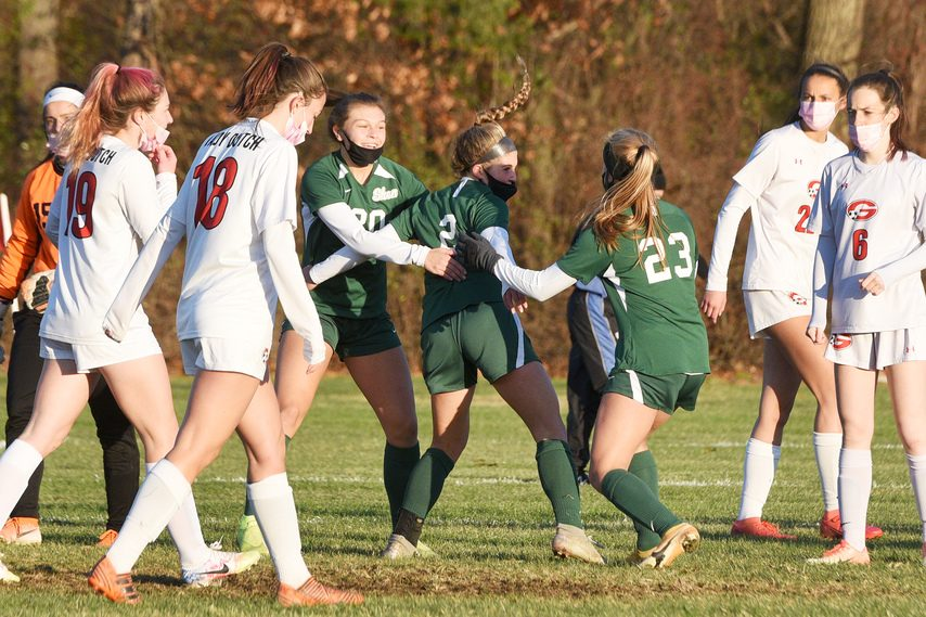 ERICA MILLER/STAFF PHOTOGRAPHERAva Caputo of Shenendehowa celebrates with teammates after scoring a goal against Guilderland Thursday in a Suburban Council girls' soccer tournament semifinal game at Shenendehowa.