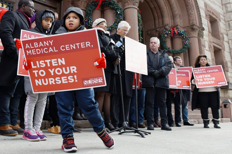 ERICA MILLER/GAZETTE PHOTOGRAPHER Adam Reynoso, 5 of Albany, holds his sign during a prayer vigil held in support of Albany Medical Center nurses who continue to fight for a fair contract and safe staffing levels on the steps of Albany City Hall on Sunday, December 15, 2019.