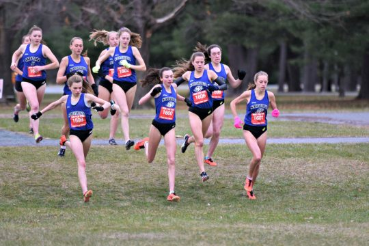 The Saratoga Springs cross country team travels as a pack at the beginning of the Suburban Council girls' cross country championships at Saratoga Spa State Park Sunday.