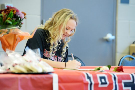 ERICA MILLER/STAFF PHOTOGRAPHER Stillwater senior Keelyn Peacock signs her National Letter of Intent to study and play soccer at Arkansas State University Tuesday at Arvin Hart Fire Department in Stillwater.