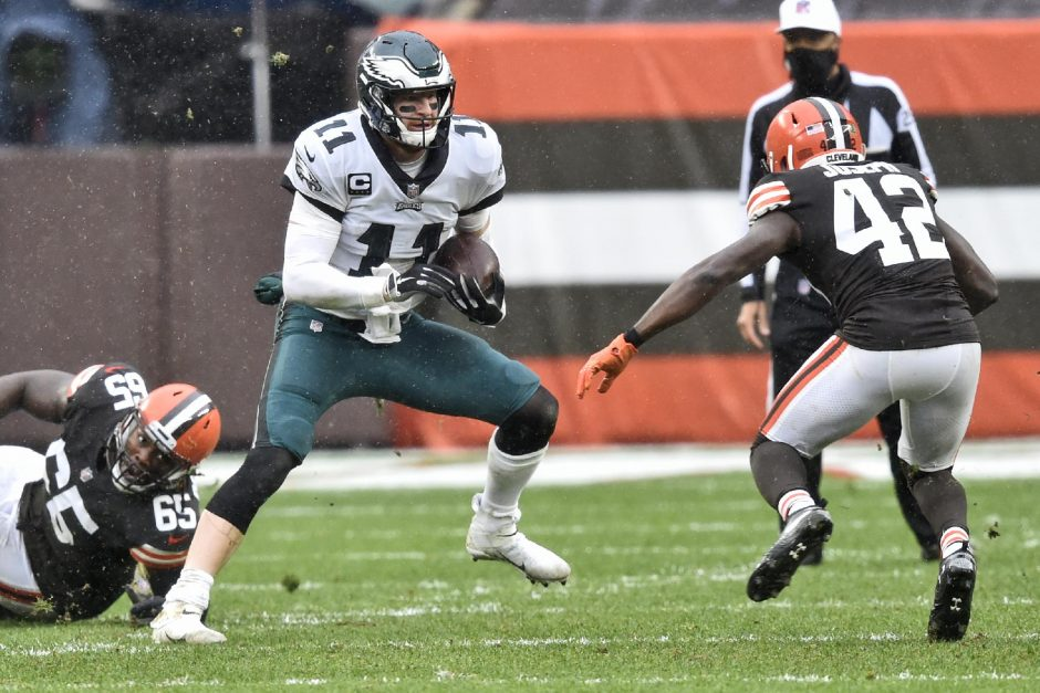 David Richard/The Associated PressPhiladelphia Eagles quarterback Carson Wentz scrambles during the first half of last Sunday's game against the Cleveland Browns in Cleveland.