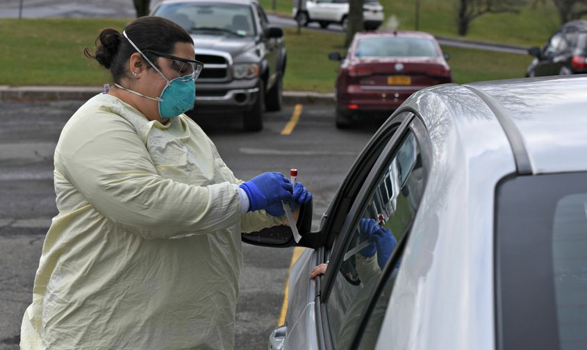 STAN HUDY/STAFF WRITERNurse Latisha L. Nasse administers a COVID-19 test at the drive-thru testing center at St. Mary's Healthcare on Route 30 in Amsterdam on Nov. 23, 2020.